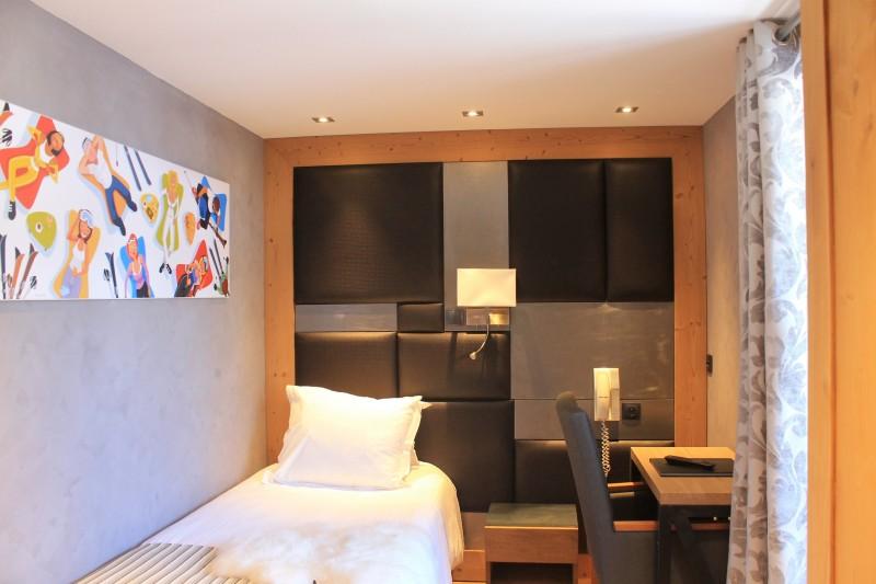 Hotel-Alpina-chambre-classique-1-personne-location-appartement-chalet-Les-Gets