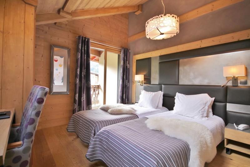 Hotel-Alpina-chambre-classique-2-personnes-location-appartement-chalet-Les-Gets