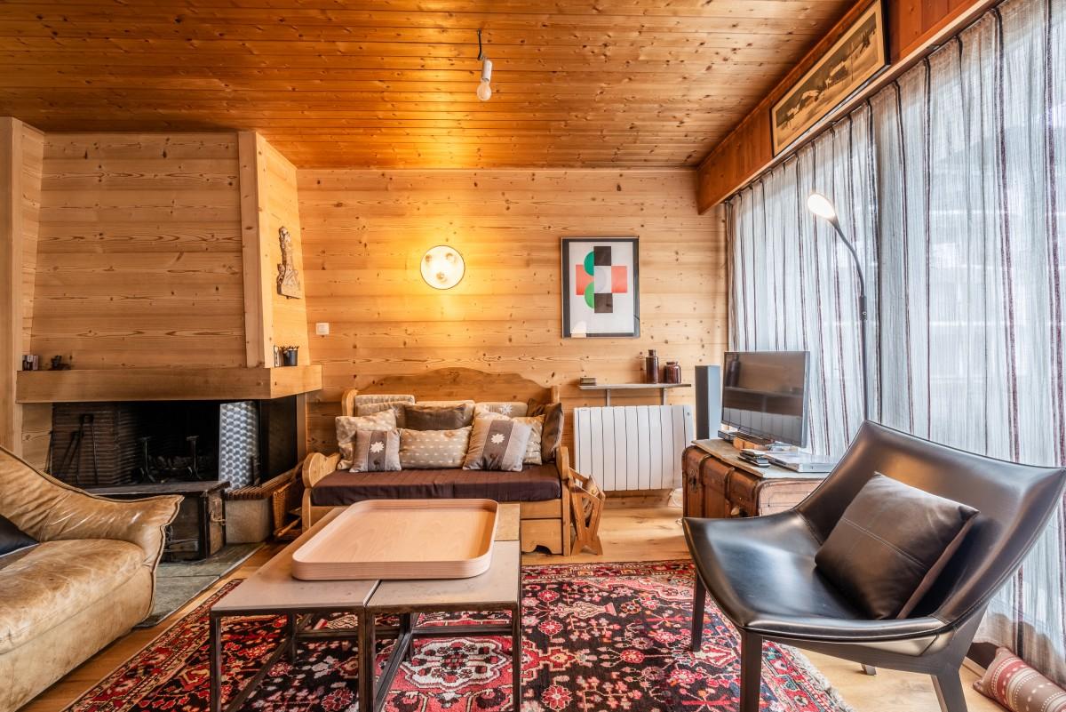 Pied-de-Adroit-5-sejour-cheminee-location-appartement-chalet-Les-Gets