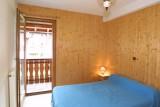 Chamioret-3-Liseron-chambre-lit-double-location-appartement-chalet-Les-Gets