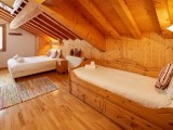 Cognee-chambre-lit-double-lit-simple-ensuite-location-appartement-chalet-Les-Gets