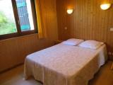 Corzolet-3-Ancolie-chambre-lit-double-location-appartement-chalet-Les-Gets