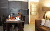 Fermes-d-Emiguy-3-pieces-alcove-8-personnes-cuisine-location-appartement-chalet-Les-Gets