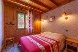 Forge-F-chambre1-lit-double-location-appartement-chalet-Les-Gets