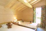 Les-Chouettes-chambre-lits-simples-location-appartement-chalet-Les-Gets