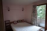 Lion-d-or-B4-chambre-lit-double-location-appartement-chalet-Les-Gets