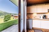 Lou-Kik-Notes-1-cuisine-vue-exterieure-location-appartement-chalet-Les-Gets
