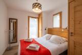 Maroussia-C2-chambre-lit-double-location-appartement-chalet-Les-Gets