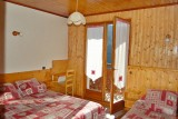 Metrallins-Muguet-chambre1-location-appartement-chalet-Les-Gets
