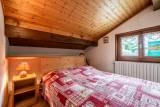 Roitelet-Les-Aires-chambre-lit-double-location-appartement-chalet-Les-Gets