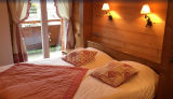 Sabaudia-3-pieces-6-personnes-chambre-lit-double2-location-appartement-chalet-Les-Gets