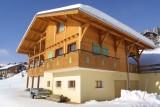 Versant-du-Soleil-Crocus-exterieur-hiver-location-appartement-chalet-Les-Gets