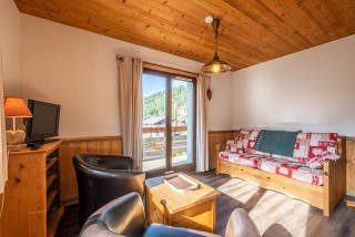 Marcelly-16-salon-location-appartement-chalet-Les-Gets