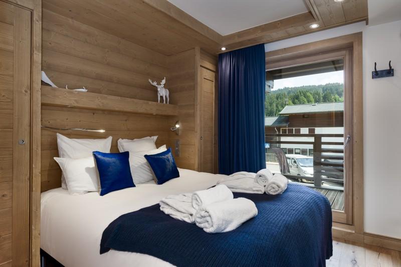 Annapurna-A105-chambre-double2-location-appartement-chalet-Les-Gets