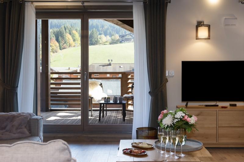 Annapurna-A302-salon-TV-location-appartement-chalet-Les-Gets