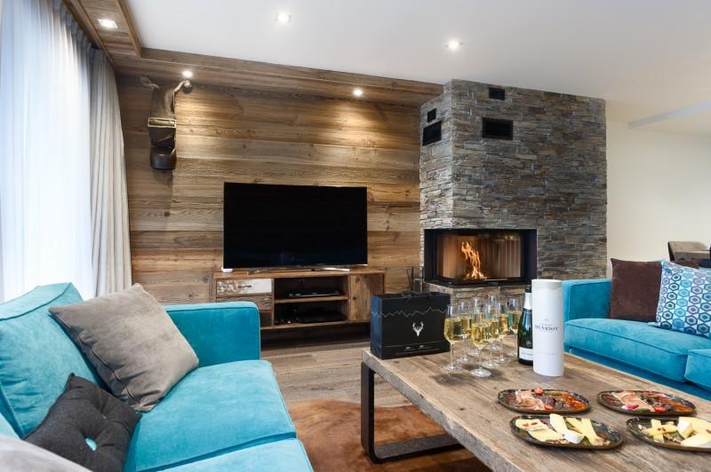 Annapurna-B201-salon-TV-cheminee-location-appartement-chalet-Les-Gets