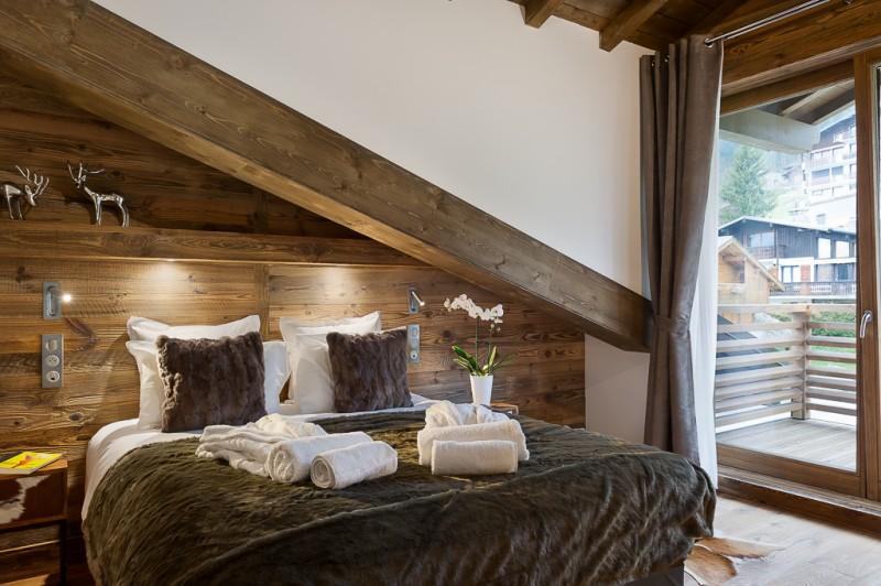 Annapurna-B302-chambre-double4-location-appartement-chalet-Les-Gets