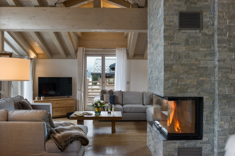 Annapurna-B304-salon-cheminee-location-appartement-chalet-Les-Gets