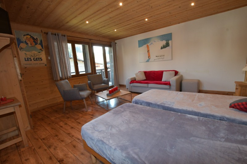 Beau-Sejour-6-salon-lits-simple-location-appartement-chalet-Les-Gets