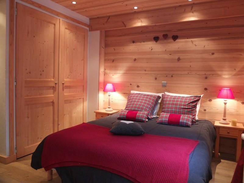 Berthet-Sports-Gentianes-chambre-lit-double-location-appartement-chalet-Les-Gets