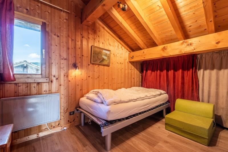 Chalet-La-Taniere-chambre-lit-simple-location-appartement-chalet-Les-Gets
