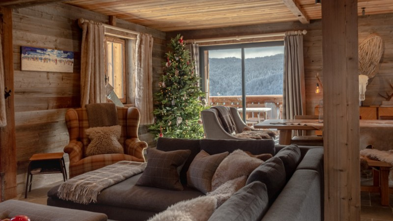 Maison-d-hiver-salon-canape-location-appartement-chalet-Les-Gets