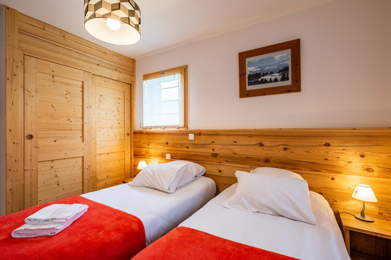 Maroussia-C2-chambre-lits-simples2-location-appartement-chalet-Les-Gets
