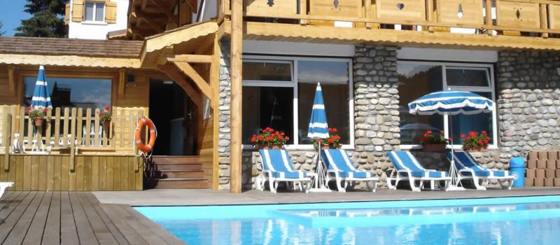 Sabaudia-6-pieces-12/14-personnes-piscine-exterieure-location-appartement-chalet-Les-Gets